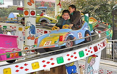 Pengzhou, China: Two Kids at Amusement Park Editorial Photo