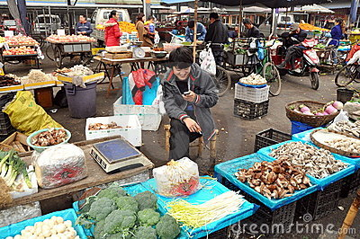 Pengzhou, China: Vendor at Market Hall Editorial Stock Image