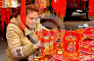 Pengzhou, China: Woman with Chinese New Year Decorations Editorial Photo