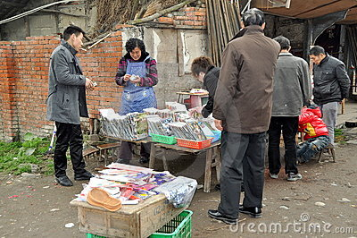 Pengzhou, China: Woman Selling DVD films Editorial Photography