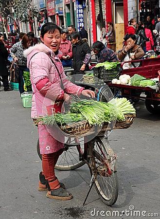 Pengzhou, China: Woman Selling Garlic Editorial Stock Image