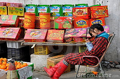 Pengzhou, China: Woman Selling New Year s Fruits Editorial Image