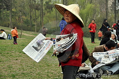 Pengzhou, China: Woman Selling Newspapers Editorial Photography