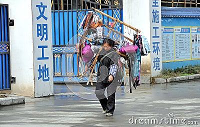 Pengzhou, China: Woman Selling Sundries Editorial Photo
