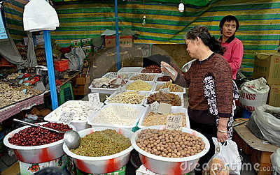 Pengzhou, China: Woman Shopping for Food Editorial Photo