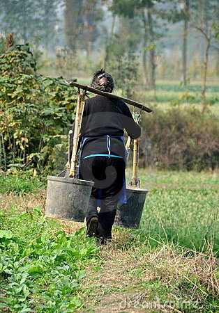 Free Pengzhou, China: Woman With Water Pails Stock Photography - 22209052