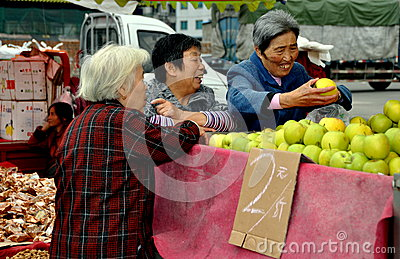 Pengzhou, China: Women Buying Apples Editorial Stock Photo