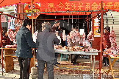 Pengzhou, China: Women Buying Meat from Butcher Editorial Photo