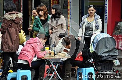 Pengzhou, China: Women Eating & Shopping Editorial Image