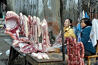 Pengzhou, China: Women Selling Pork Editorial Image