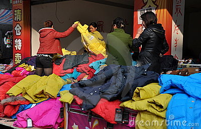 Pengzhou, China: Women Shopping for Coats Editorial Image
