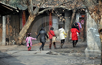 Pengzhou, China: Women Walking on Hua Lu Editorial Stock Photo