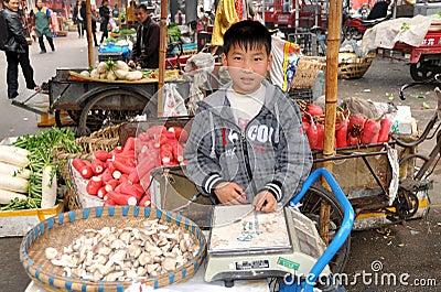Pengzhou, China:  Young Boy Selling Mushrooms Editorial Photo