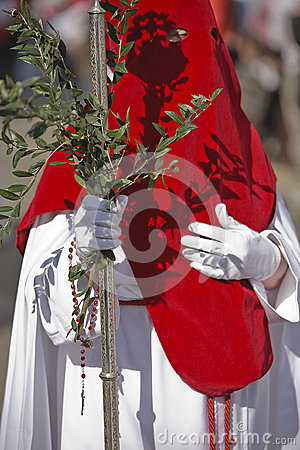 Penitent with a crosier carried olive branches during a procession of holy week on Palm Sunday Editorial Stock Image