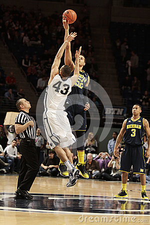 Penn State s Ross Travis and Michigan s Jordan Morgan jump Editorial Photo