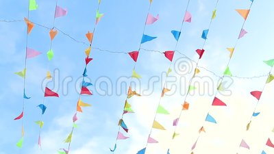 Pennant flying in the wind with cute solid blu sky background. Hand shot stock video