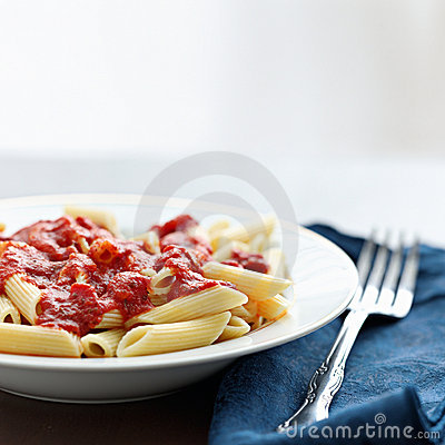 Penne pasta in tomato sauce with copyspace