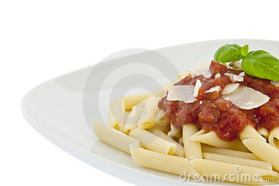 Penne with sauce, basil and chese on a plate