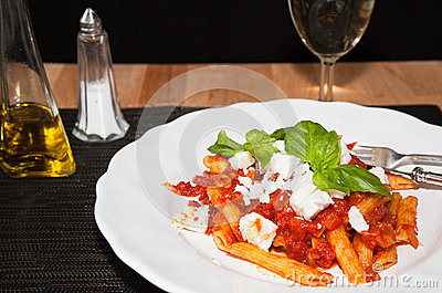 Penne and tomatoe sauce, with cheese and basil.
