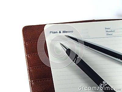 Pens on a memo agenda