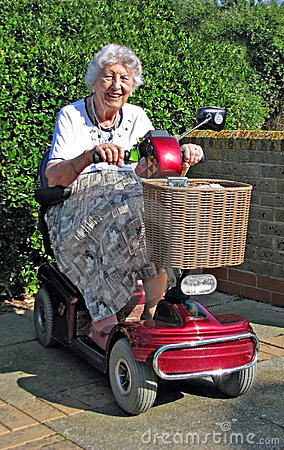 Free Pensioner Demonstrating Mobility Scooter Stock Images - 20972374
