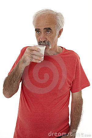 Pensioner drinking milk