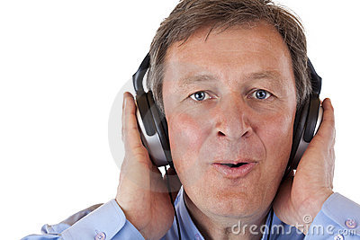 Pensioner with headphones singing to mp3 music