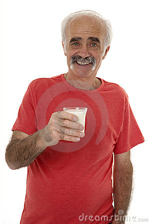 Pensioner holding glass of milk