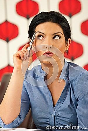 Pensive amazed business woman