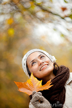 Pensive autumn woman