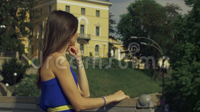 Thoughtful adult woman looking away on the bridge stock video footage