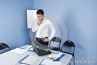 Pensive business man in meeting room