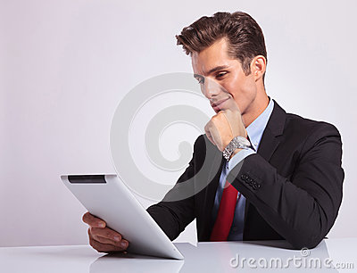 Pensive business man on tablet