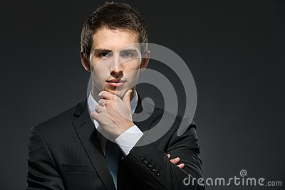 Pensive business man touches his face
