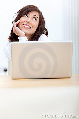 Pensive business woman with laptop