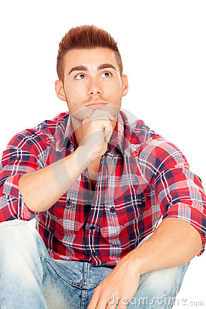 Pensive casual boy with plaid shirt
