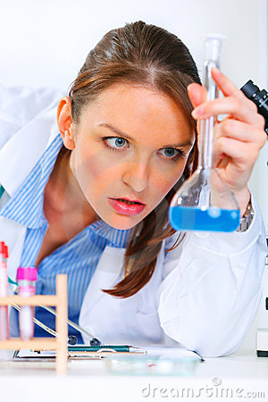 Pensive doctor woman analyzing results of test