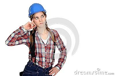 Pensive female builder