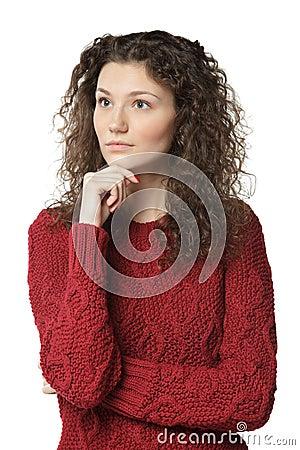 Pensive female in sweater