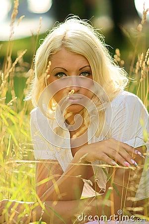 Pensive girl in grass