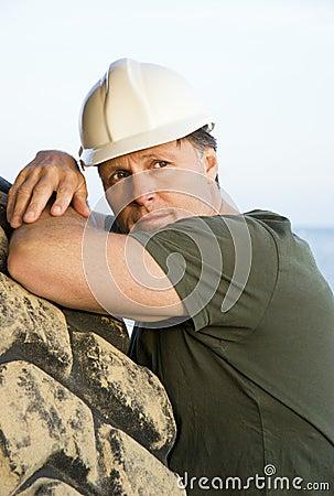 Pensive looking construction worker