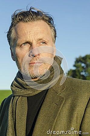 Pensive looking mature man with beard