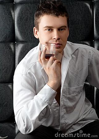 Pensive man with glass of whiskey