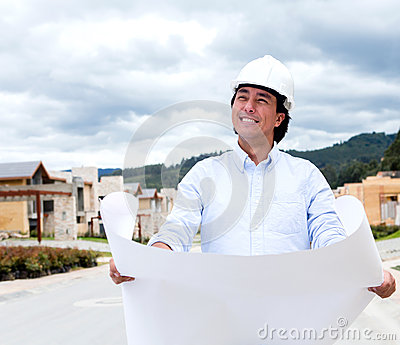 Pensive man holding blueprints