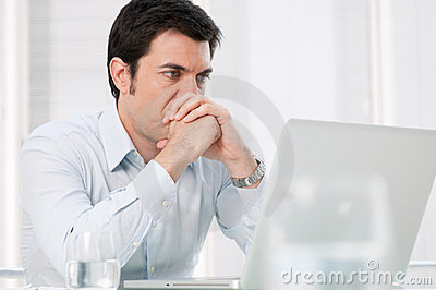 Pensive man at laptop