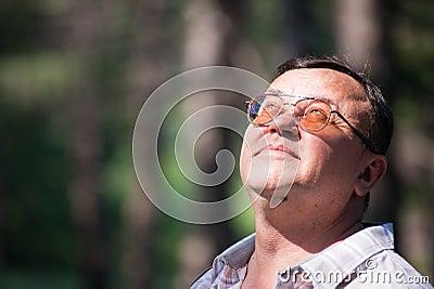 Pensive man looking up