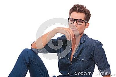 Pensive man sitting