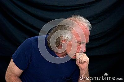 Pensive man in T-shirt on black