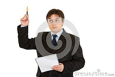 Pensive modern businessman with notebook got idea