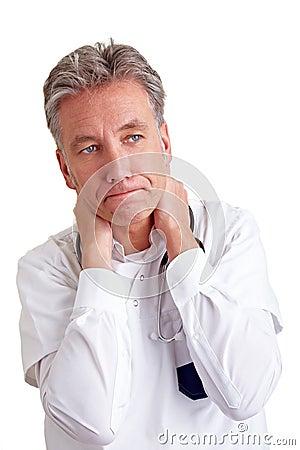 Pensive senior physician
